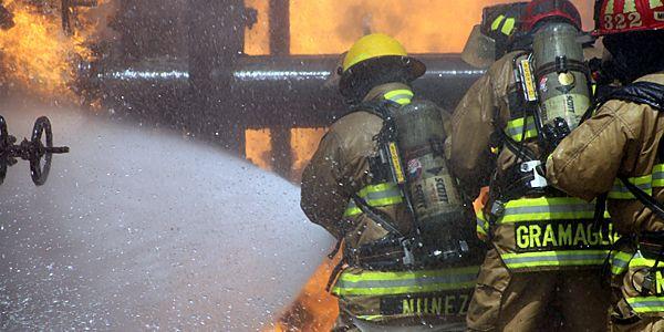 Firefighters Nunez and Gramaglia battle fire prop.