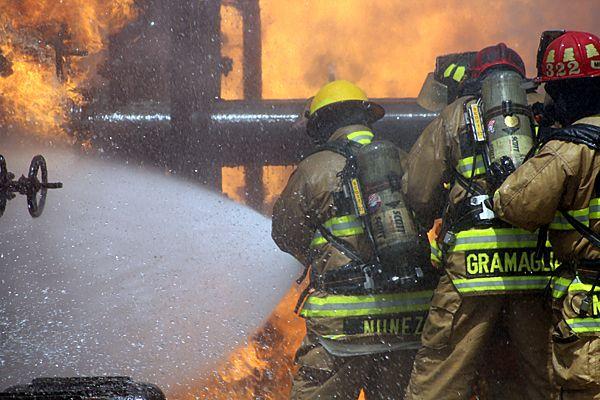Firefighters Nunez and Gramaglia battle fire prop. - Photo by Anton Riecher