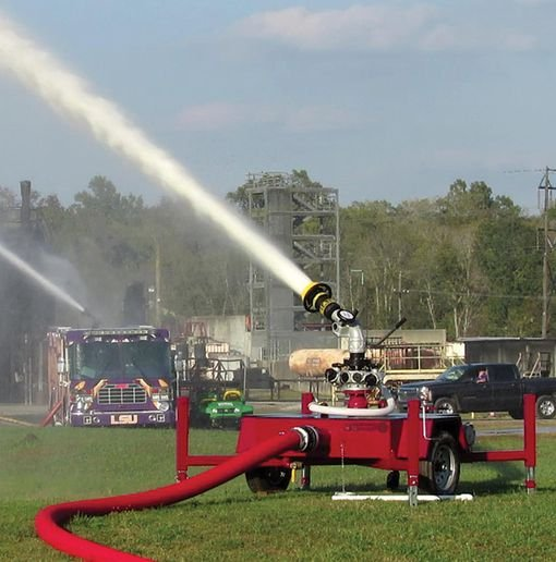 A US Fire Pump trailer deck gun contributes an additional 2,000 gpm to the flow. - Photo by Anton Riecher