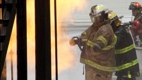 Campbell manages the nozzle during Xtreme fire school training at Brayton in June.