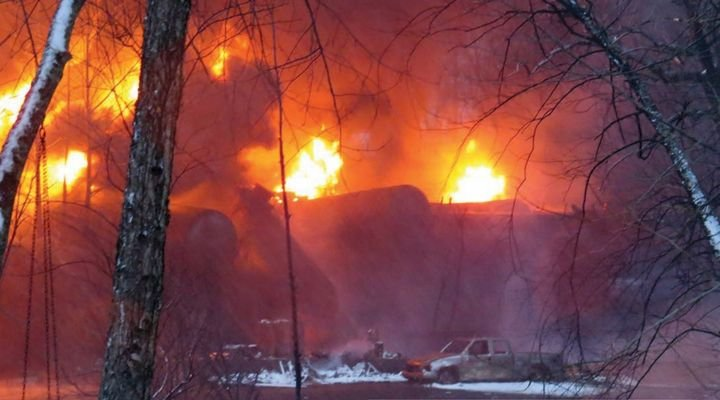 Flames roar from the wreckage after 28 cars of a 109-tank car train carrying crude derailed in Mount Carbon, WV, on February 16. - Photo by John Taylor / South Charleston Fire Dept.