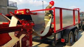 Hose collected using the Hose Cart can easily be transferred to another vehicle too cumbersome to maneuver through a maze of multiple lines. - Photo courtesy of Baker Fabrication