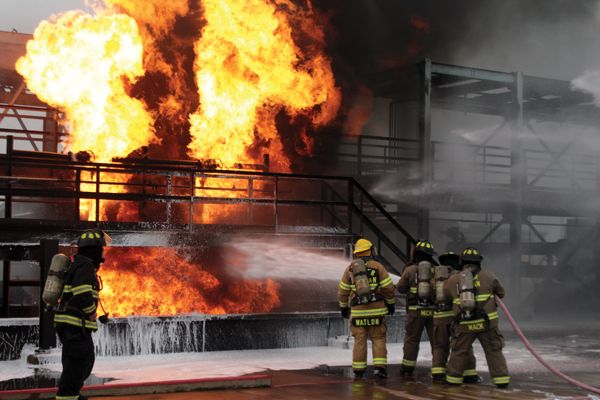 Responders challenge the Refinery Terminal Fire Company's live-fire process training unit in Texas - Photo by Anton Riecher.