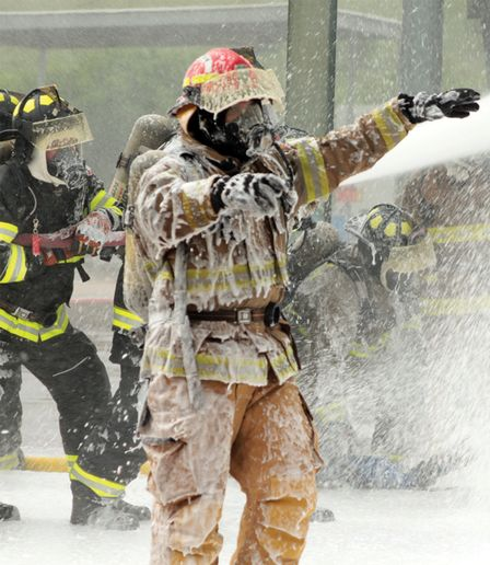 Responders caught in foam blizzard. Training at RFTC utilizes the actual foam used by emergency responders, not training foam. - Photo by Anton Riecher.