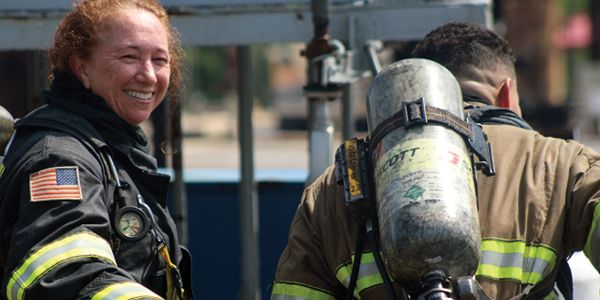 Chevron responder Corena LeDonne lends support to a fellow firefighter having a rough time with...