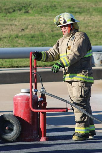 J.R. Nerat demonstrates a wheel unit extinguisher during the annual Hellfighter U training at TEEX. - Photo by Anton Riecher