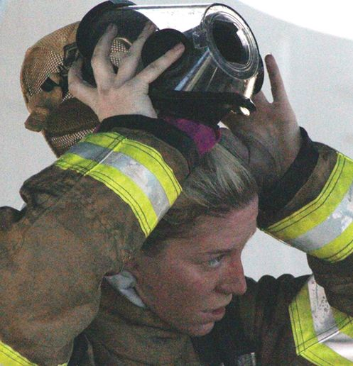 Paquin dons SCBA for a training exercise. - Photo by Anton Riecher