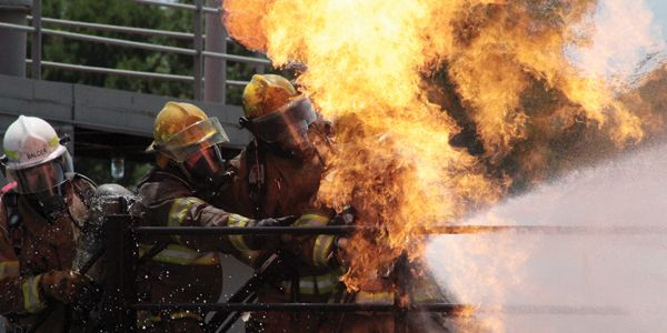 Paquin's hose team tackles a live-fire prop at TEEX.