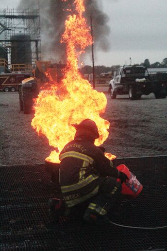 US Fire Pump's chief engineer Ryan Nawrocki works up close to the flames. - Photo by Anton Riecher