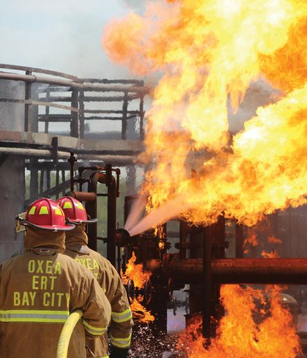 Participants test their skills against a burning flange leak from a pressurized fuel source. - Photo by Anton Riecher
