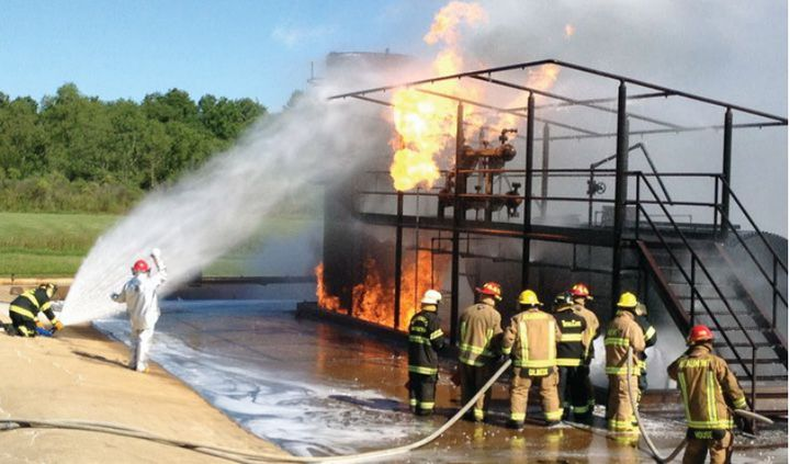 Students fight fire during BEST October fire school in Beaumont, TX -