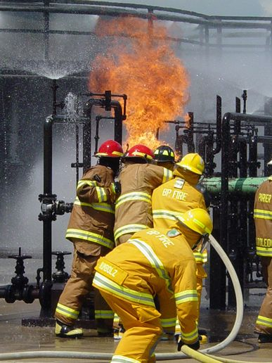 Firefighters move in to close valves. -