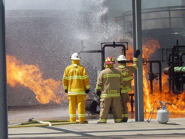 Foam is applied to the burning bulk storage unit prop. - Photos by Anton Riecher