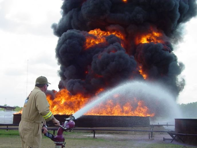 Chauncey Naylor operates a monitor during a tank fire demo. - Photo by Anton Riecher