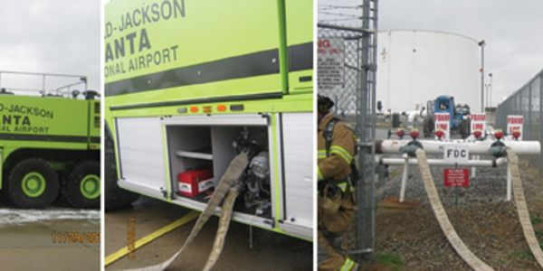 The yellow hose is water resupply from an airport hydrant. The white hoses connect the vehicle 2...
