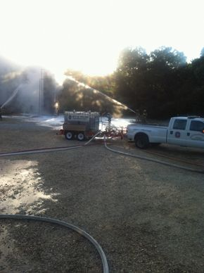 Collins, MS, foam trailer brought to bear against tank fire. -
