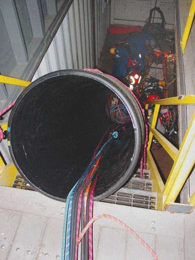 Tube and stairway used to simulate confined space rescue. -