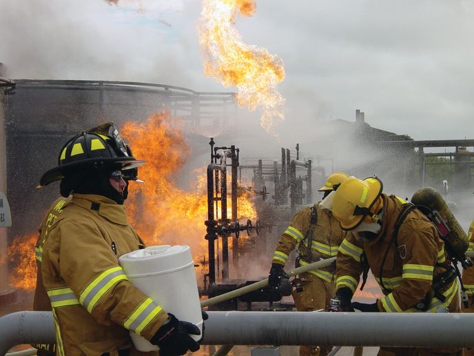Firefighters prepare for a foam attack during a live-fire exercise at Texas A&M. - Photos by Anton Riecher