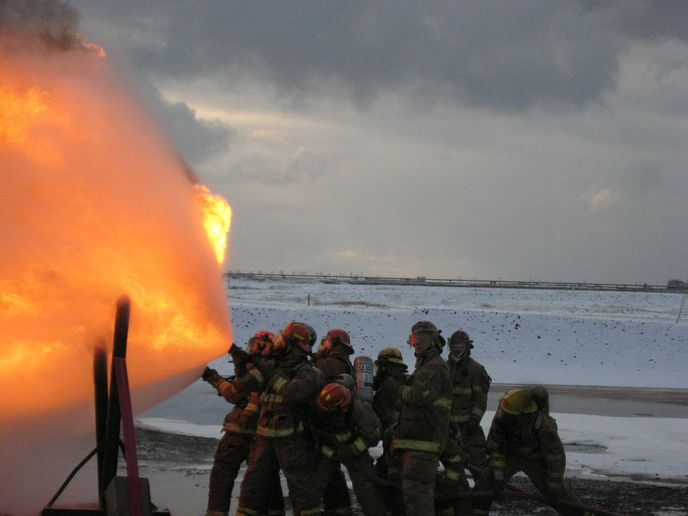 Firefighters with the Greater Prudhoe Bay Fire Department tackle live-fire props at their training field. - Photos courtesy of GPBFD
