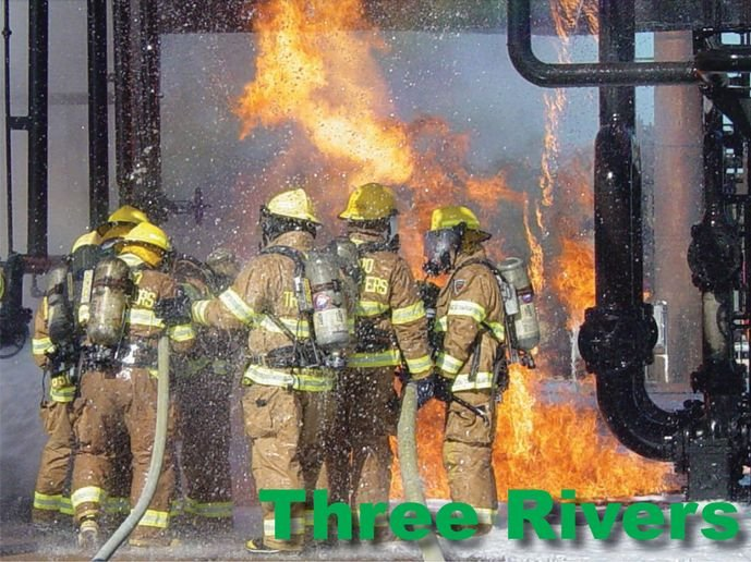 Three Rivers firefighters tackle a burning overhead pipe rack prop. - Photo by Anton Riecher