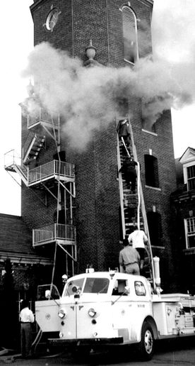 OSU student firefighters apply their training to a genuine fire. - Photo provided by the Fire Protection Publications Archives.