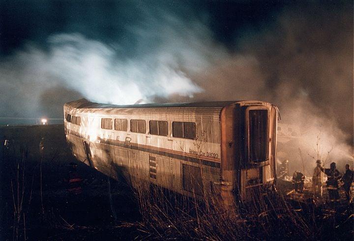 Smoke fromburning diesel fuel shrouds a derailed passenger car. - Photo by Fred Ruetz/Braidwood Fire Department.