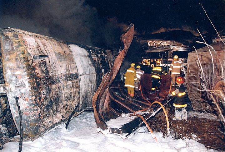 Firefighters work their way along the train searching for casualties. - Photo by Fred Ruetz/Braidwood Fire Department.