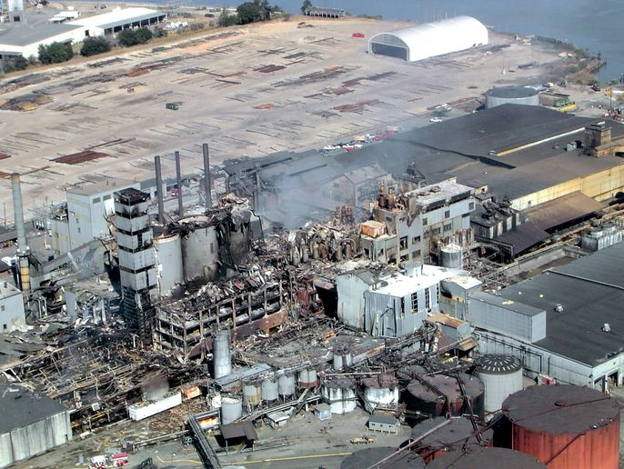 Aerial of the smoldering sugar refinery after the explosion - Photo courtesy of U.S. Coast Guard.