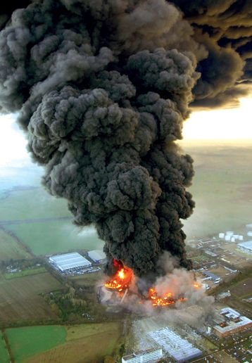 Smoke spreads across the southeastern U.K. from the Buncefield oil depot. - Photo courtesy of Chiltern Air Support Unit.