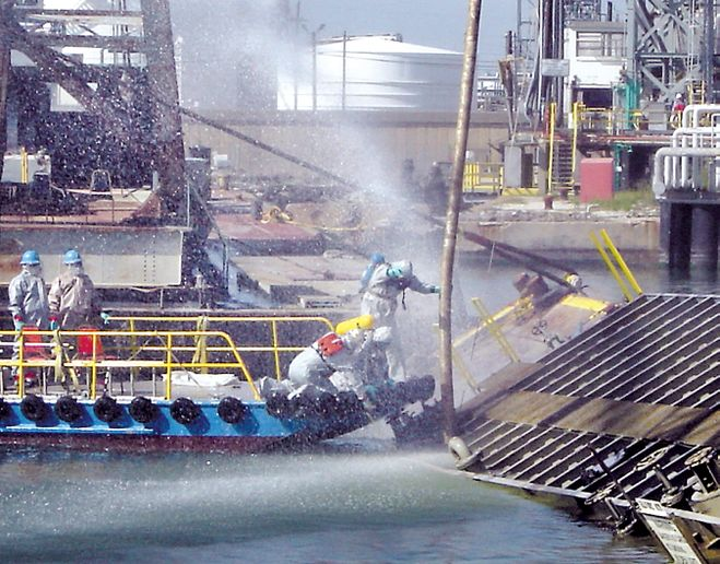 Workers must wear Level A hazmat gear. - Photo courtesy of U.S. Coast Guard.
