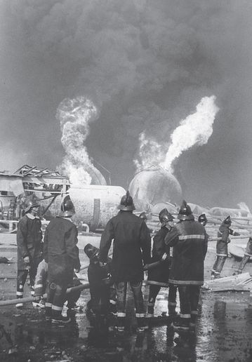 Firefighters survey the aftermath of a cataclysmic LPG explosion in Mexico. - Photo by David White.