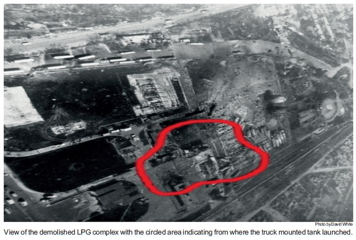 View of the demolished LPG complex with the circled area indicating where the truck-mounted tank launched. - Photo by David White.