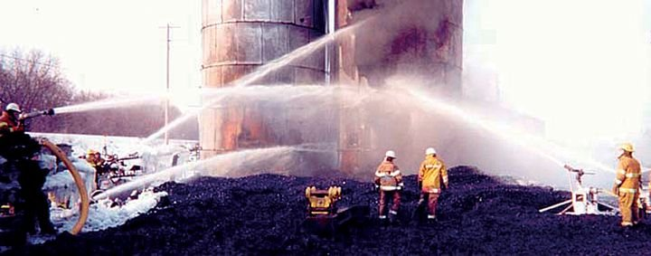 Williams Fire & Hazard Control takes charge of the smoldering fire in EnTire's last two silos. - Photo by Larry Wiles.
