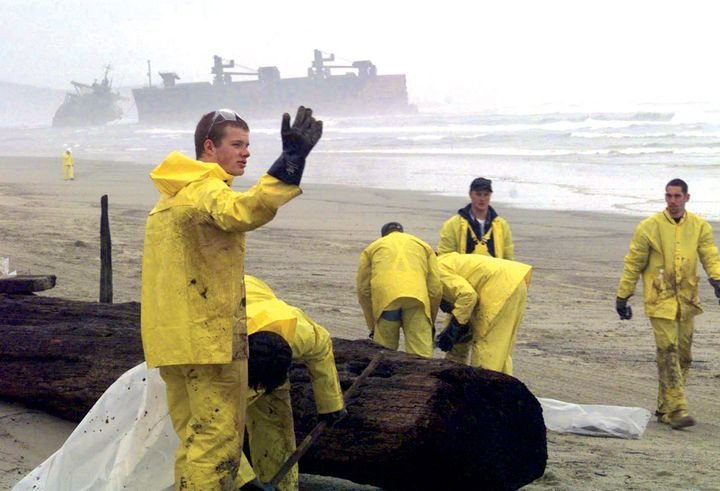 Workers protect an Oregon beach against a massive oil spill. - Photo by Brandon Brewer/USCG.