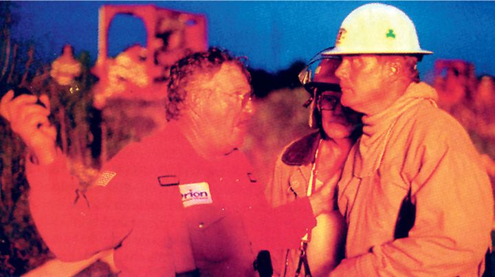 Refinery fire chief J.R. Chidester, left, confers with firefighter Dwight Williams. - Photo by David White.