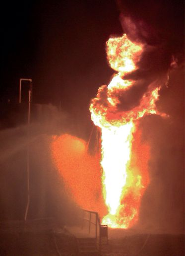 Burning crude runs down the side of a fiberglass storage tank. - Photo courtesy of Plainville VFD.