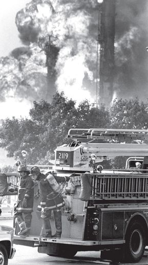 Firefighters arrive at a burning refinery in Romeoville, Illinois, in July 1984. - Photo by John Patsch/Joliet Herald News.