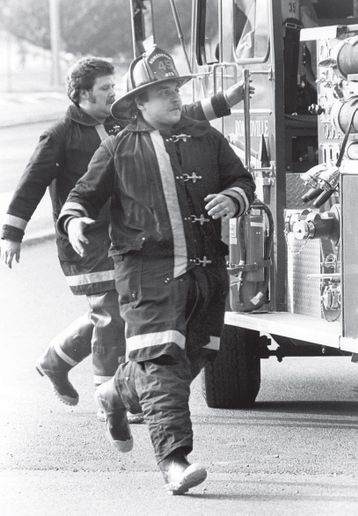Responders rush to move their fire trucks. - Photo by John Patsch/Joliet Herald News.