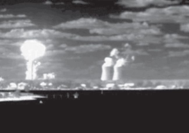 The explosion is captured by an infrared camera more than four miles away. The cooling towers to the right of the blast belong to a nearby power station. - Photo courtesy of U.S. Coast Guard.