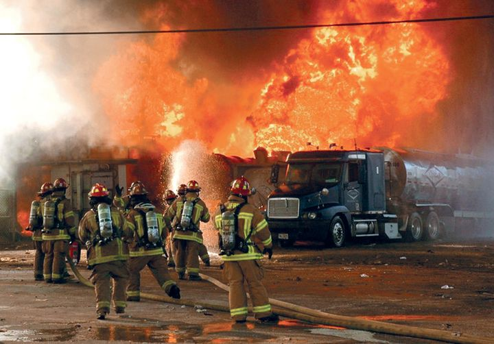 Flames at T2 Laboratories threaten tankers and tube trailers parked at the site. - Photo by Steve Gerbert.