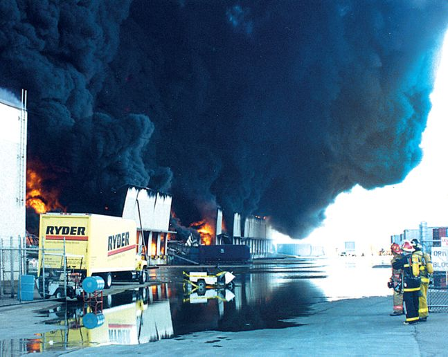 In July 1995, flames swept through the remaining warehouse in minutes. - Photo by Tom McDonald.