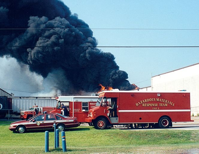 Hazmat responders on the scene of the first warehouse fire in June 1995. - Photo by Tom McDonald.