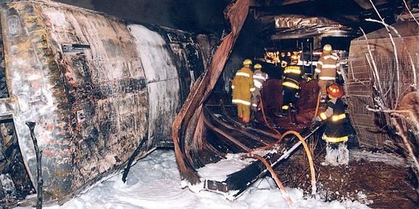 Firefighters work their way along the train searching for casualties.