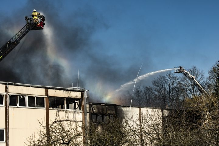 A German firefighter from Otterberg sprays water on a burning factory in Otterberg, Germany, March 23, 2020. The building had been on fire since approximately 2 p.m. the previous day and the 86th Civil Engineer Squadron Fire and Emergency services responded at about 4 p.m. to assist with water resupply. - U.S. Air Force photo by Airman 1st Class Jennifer Gonzales