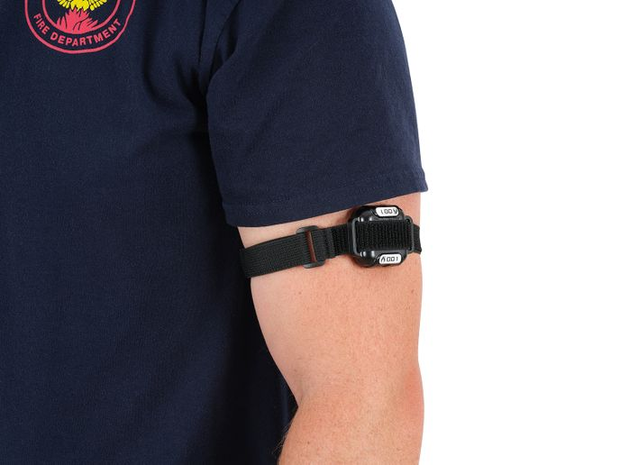 Firefighters wear the BioTrac device underneath their PPE on their arm next to their skin. -