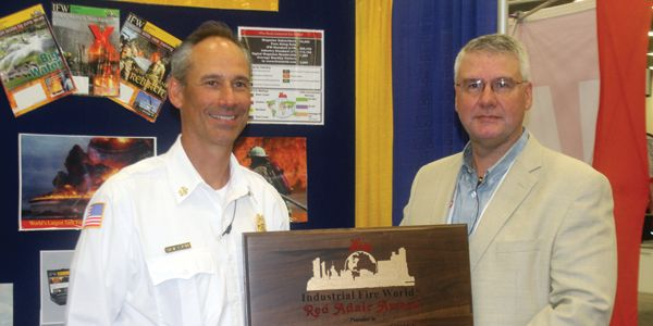 Superior, WI Fire Chief Steve Panger, left, received the 2018 Red Adair Award in August. Kollin...