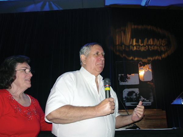 David White, with wife Lynn, accepts Red Adair Award at Xtreme. - Photo by Anton Riecher
