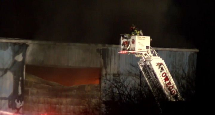 Firefighters battle recycling plant fire Jan. 3 in Apalachin, New York. - Screencapture Via WBNG