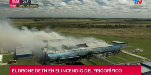 Flames race through the Cabaña Argentina meat processing plant on January 1.