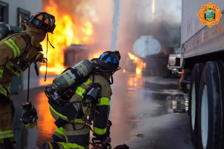Firefighters take up positions at an oil recycling plant fire Wednesday in Florida.